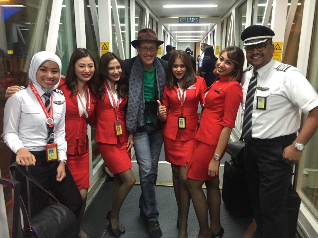 Richard Quest of CNN Business Traveller poses with the AirAsia flight crew