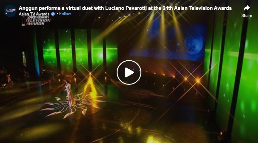 anggun performs a virtual duet with luciano pavarotti at the 24th asian television awards